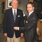 Coach Jim Boeheim, Syracuse men's basketball, being fitted by Vince Rua